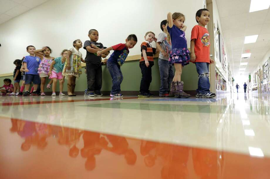 In this file photo, pre-K students line up outside a classroom at the South Education Center. Recently released data from a study of Texas school students conducted by the Houston-based nonprofit Children at Risk indicates that children who have access to high-quality, full-day pre-K programs perform significantly better than their peers in the third grade on the State of Texas Assessments of Academic Readiness. Photo: Eric Gay /Associated Press / AP