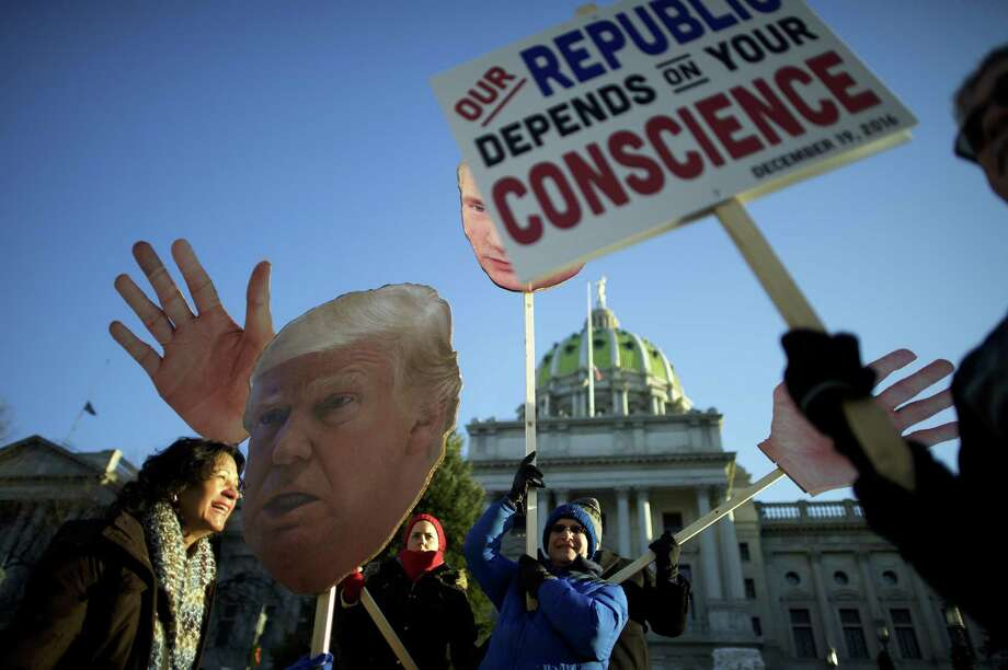 Donald Trump protestors demonstrate outside the Pennsylvania Capitol Building before electors arrive to cast their votes from the election Dec. 19 in Harrisburg, Pennsylvania. A reader says such rallies were a sad reflection of our divisiveness. Photo: Mark Makela /Getty Images / 2016 Getty Images