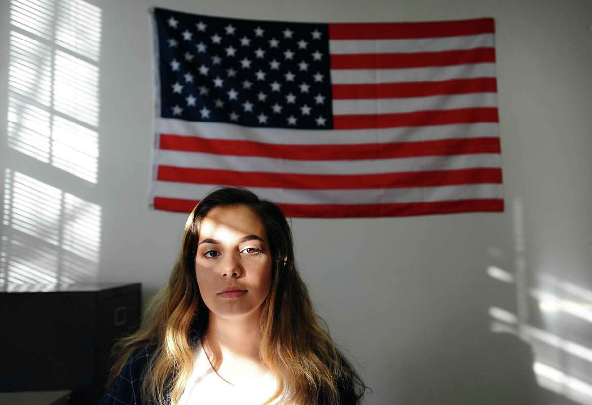 """Georgia Pensiero, 16, poses for a photo inside Stamford High School in Stamford, Conn. on Wednesday, Dec. 14, 2016. Medero attends after school meetings hosted by the Center for Sexual Assault Crisis Counseling and Education to learn about sexual assault laws and how to prevent, and respond to, sexual assault. It worries me that a lot of other people dont know much about it at all,"""" she said."""