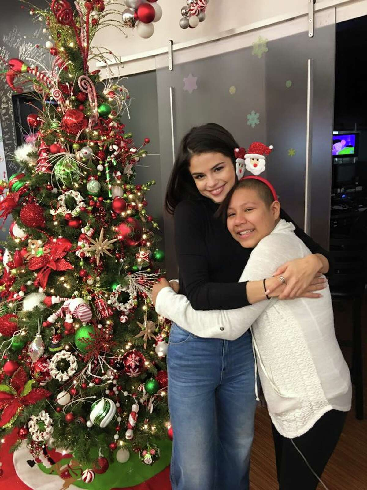 """Selena Gomez was the """"hometown girl"""" with a big heart on Christmas Eve when she surprised young patients at Cook Children's Hospital in Fort Worth."""