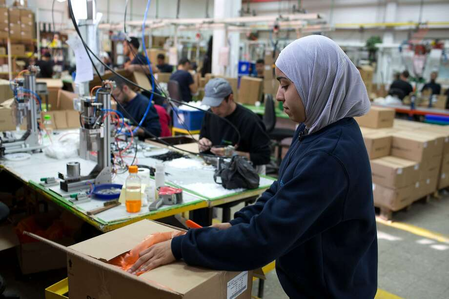 A Palestinian woman works at a SodaStream factory on 2014 in the Mishor Adumim industrial park, next to the West Bank settlement of Maale Adumim. SodaStream closed the factory the next year amid a campaign to boycott companies doing business in illegal settlements in the West Bank. Photo: MENAHEM KAHANA, AFP/Getty Images