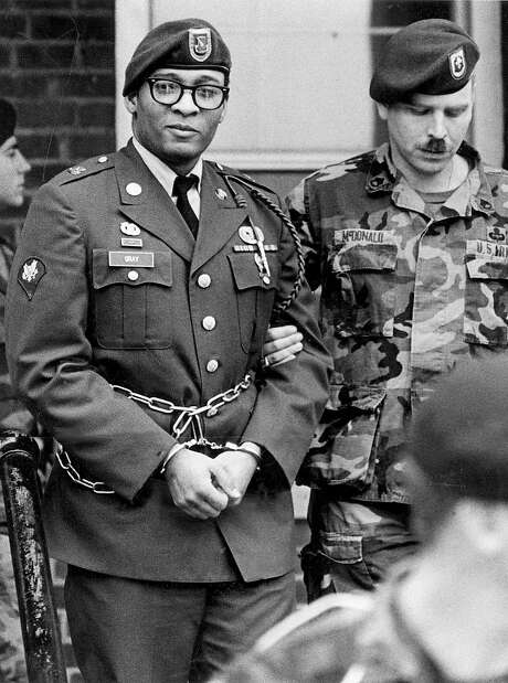 FILE - In this April 6, 1988, file photo, Ronald Gray leaves a courtroom escorted by military police at Fort Bragg, N.C. A Kansas federal judge has lifted a stay of execution for Gray, a former soldier who was sentenced to death for killing two women and a series of rapes, moving him closer to becoming the military's first death sentence carried out in more than a half century. No known execution date has been set for Gray as of Tuesday, Dec. 27, 2016. (Marcus Castro/The Fayetteville Observer via AP, File) Photo: Marcus Castro, Associated Press