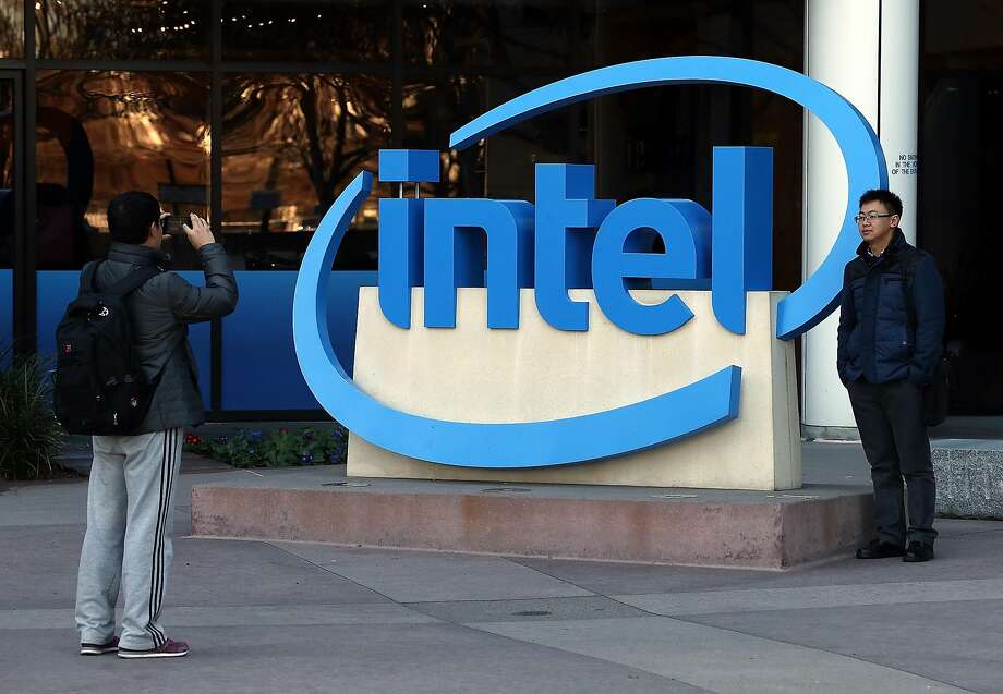 Visitors take pictures next to the Intel logo outside of the Intel headquarters in Santa Clara in 2014. One of Intel's law firms was recently targeted by hackers seeking to profit from inside knowledge of deals. Photo: Justin Sullivan, Getty Images