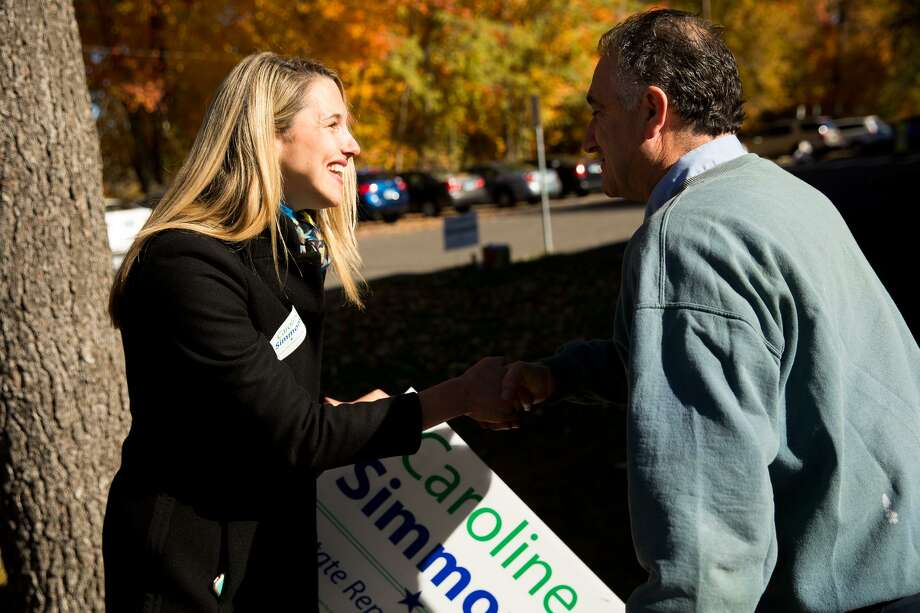 Caroline Simmons greets voters outside Stillmeadow Elementary School in Stamford Tuesday morning, Nov. 8, 2016. Photo: Chris Palermo / For Hearst Connecticut Media / Greenwich Time Freelance