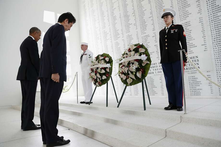 President Barack Obama and Japanese Prime Minister Shinzo Abe participate in a wreath laying ceremony at the USS Arizona Memorial, part of the World War II Valor in the Pacific National Monument, in Joint Base Pearl Harbor-Hickam, Hawaii, adjacent to Honolulu, Hawaii, Tuesday, Dec. 27, 2016, as part of a ceremony to honor those killed in the Japanese attack on the naval harbor. (AP Photo/Carolyn Kaster) Photo: Carolyn Kaster, Associated Press