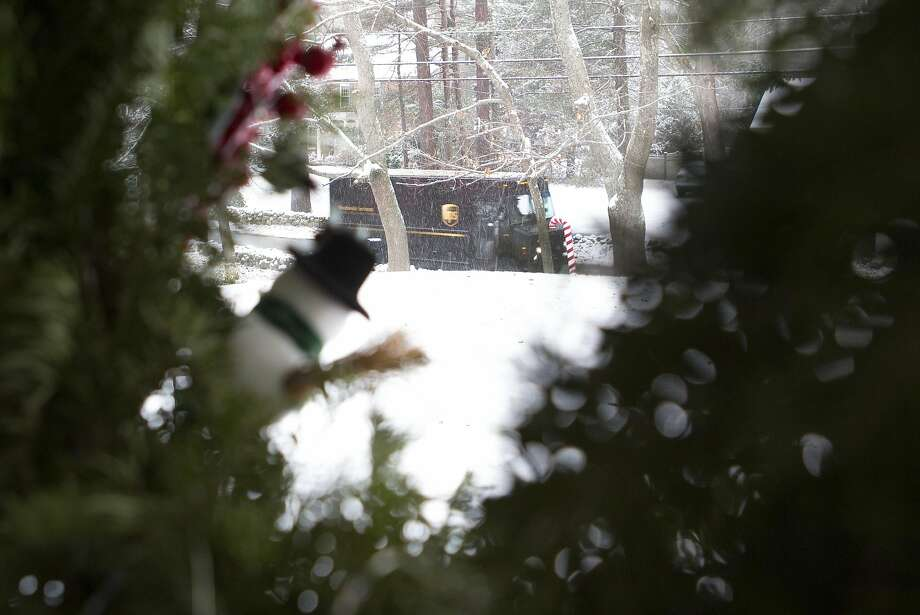 UPS trucks made plenty of deliveries ahead of the holidays, but the delivery company is gearing up for its busiest day of returns next week. About 1 in 10 presents are returned. Photo: Mary Schwalm, Associated Press