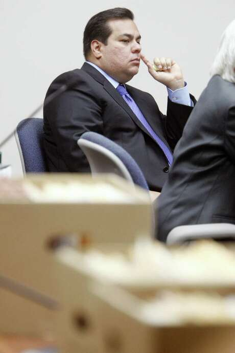 Defendant Mauricio Celis listens to testimony as boxes of the prosecution's documents line the tables Tuesday, Feb. 10, 2009, during the opening day of the first criminal trial against Celis at the Nueces County Courthouse in Corpus Christi. Celis is facing 23 counts of falsely holding himself out as a lawyer. (AP Photo/Corpus Christi Caller-Times,/Michael Zamora) Photo: Michael Zamora, MBO / AP / Corpus Christi Caller-Times