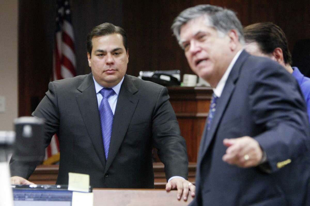Defendant Mauricio Celis gathers with his lawyers, including lead attorney Tony Canales (right) as they break for lunch Tuesday, Feb. 10, 2009, during the opening day of the first criminal trial against Celis at the Nueces County Courthouse in Corpus Christi. Celis is facing 23 counts of falsely holding himself out as a lawyer. (AP Photo/Corpus Christi Caller-Times,/Michael Zamora)