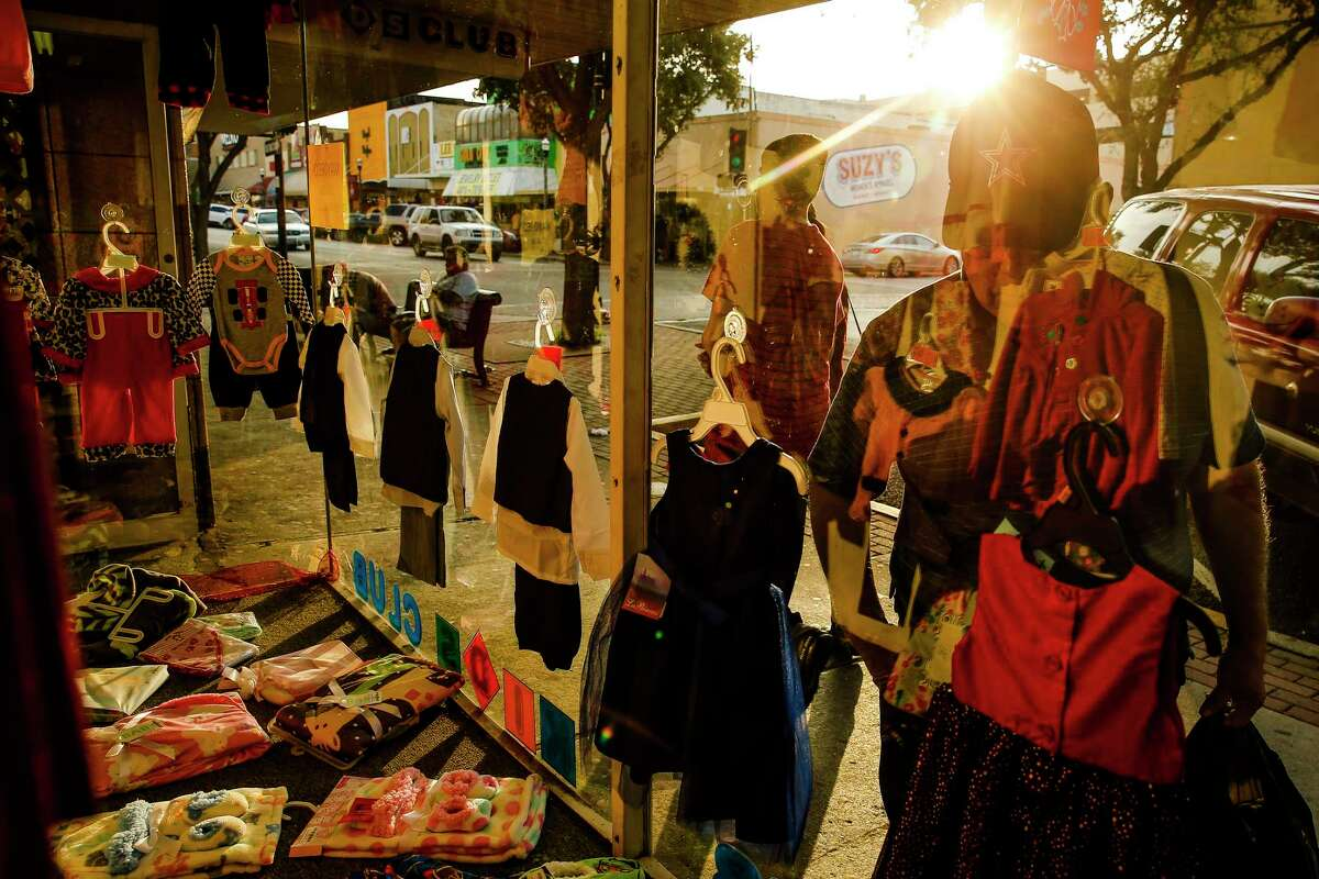 A man window shops outside Kids Club Friday, Dec. 16, 2016 in downtown McAllen. Store owners in border towns such as McAllen depend on shoppers from Mexico. ( Michael Ciaglo / Houston Chronicle )