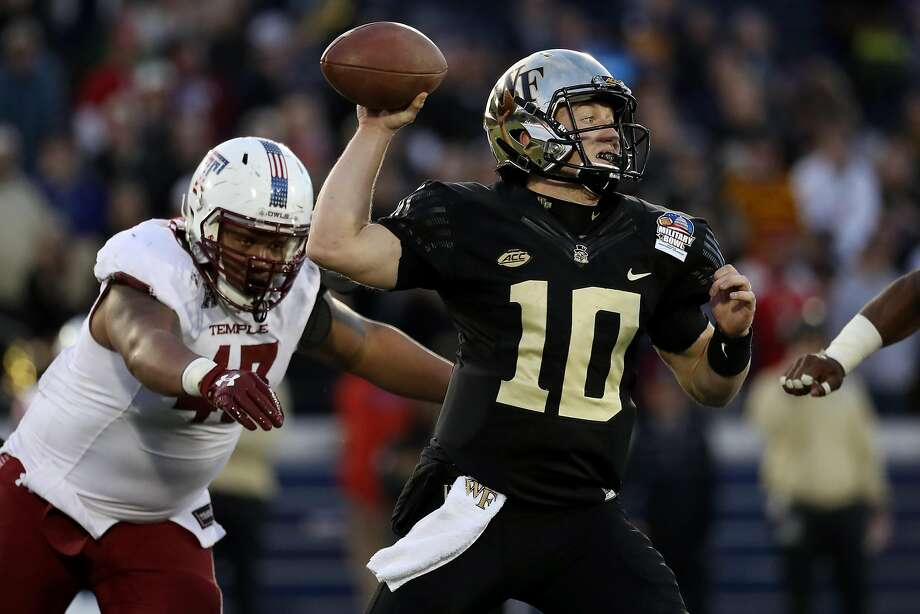 Quarterback John Wolford helped Wake Forest score 31 consecutive points in the first half. He left the game in the third quarter. Photo: Matt Hazlett, Getty Images