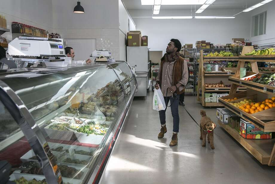 Lowell Caulder checks out the deli with his dog Moses at Luke's Local on Tuesday, Dec. 27, 2016 in San Francisco, Calif. Photo: Santiago Mejia, The Chronicle