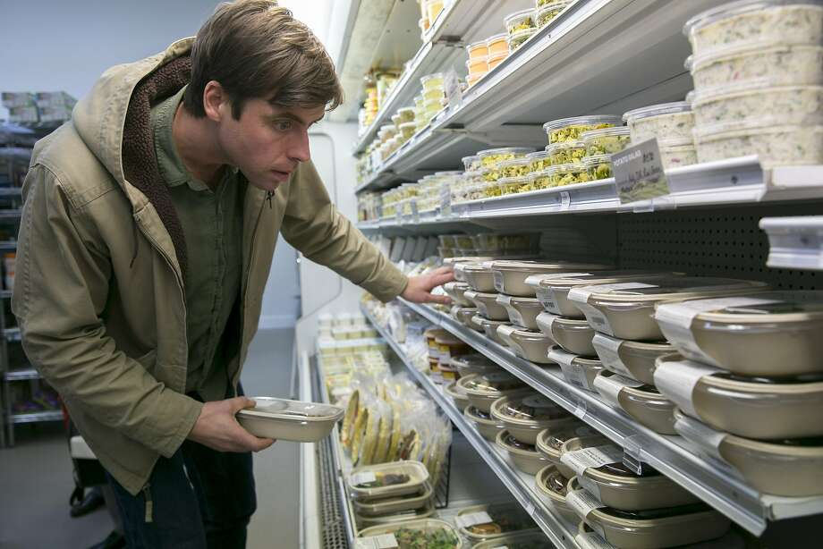 Luke Chappell organizes the food at Luke's Local on Tuesday, Dec. 27, 2016 in San Francisco, Calif. Chappell is the business owner. Photo: Santiago Mejia, The Chronicle