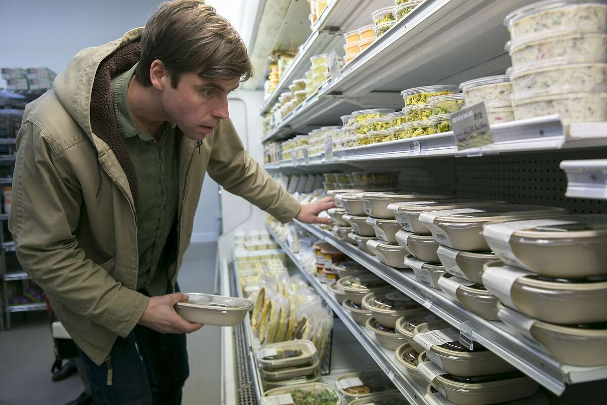 Luke Chappell organizes the food at Luke's Local on Tuesday, Dec. 27, 2016 in San Francisco, Calif. Chappell is the business owner.