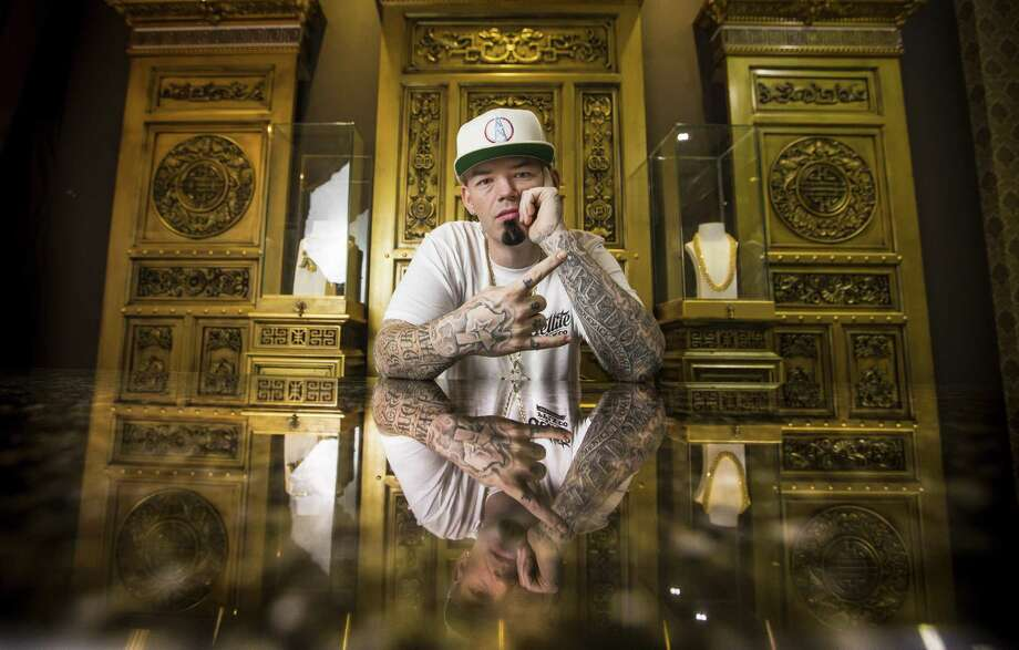 Houston rapper Paul Wall sits behind a desk in the VIP area of his new custom grillz store, Johnny Dang & Co., Tuesday, Oct. 25, 2016 in Houston. ( Michael Ciaglo / Houston Chronicle ) Photo: Michael Ciaglo, Staff / Houston Chronicle / © 2016  Houston Chronicle