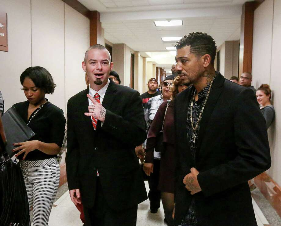 Paul Slayton, center, better known as Houston rapper Paul Wall, enters the 262nd Criminal Court at the Harris County Criminal Justice Center on Tuesday. Slayton, 35, was arrested last week with nine other people at a Heights-area smoke shop. Photo: Jon Shapley, Staff / © 2015  Houston Chronicle