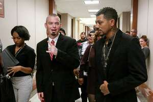 Paul Slayton, center, better known as Houston rapper Paul Wall, enters the 262nd Criminal Court at the Harris County Criminal Justice Center on Tuesday. Slayton, 35, was arrested last week with nine other people at a Heights-area smoke shop.