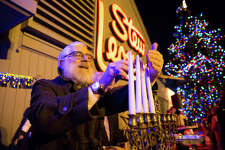 Rabbi Yehoshua Hecht lights the menorah to celebrate the fourth night of Hanukkah at Stew Leonards in Norwalk, Conn. on December 27, 2016.