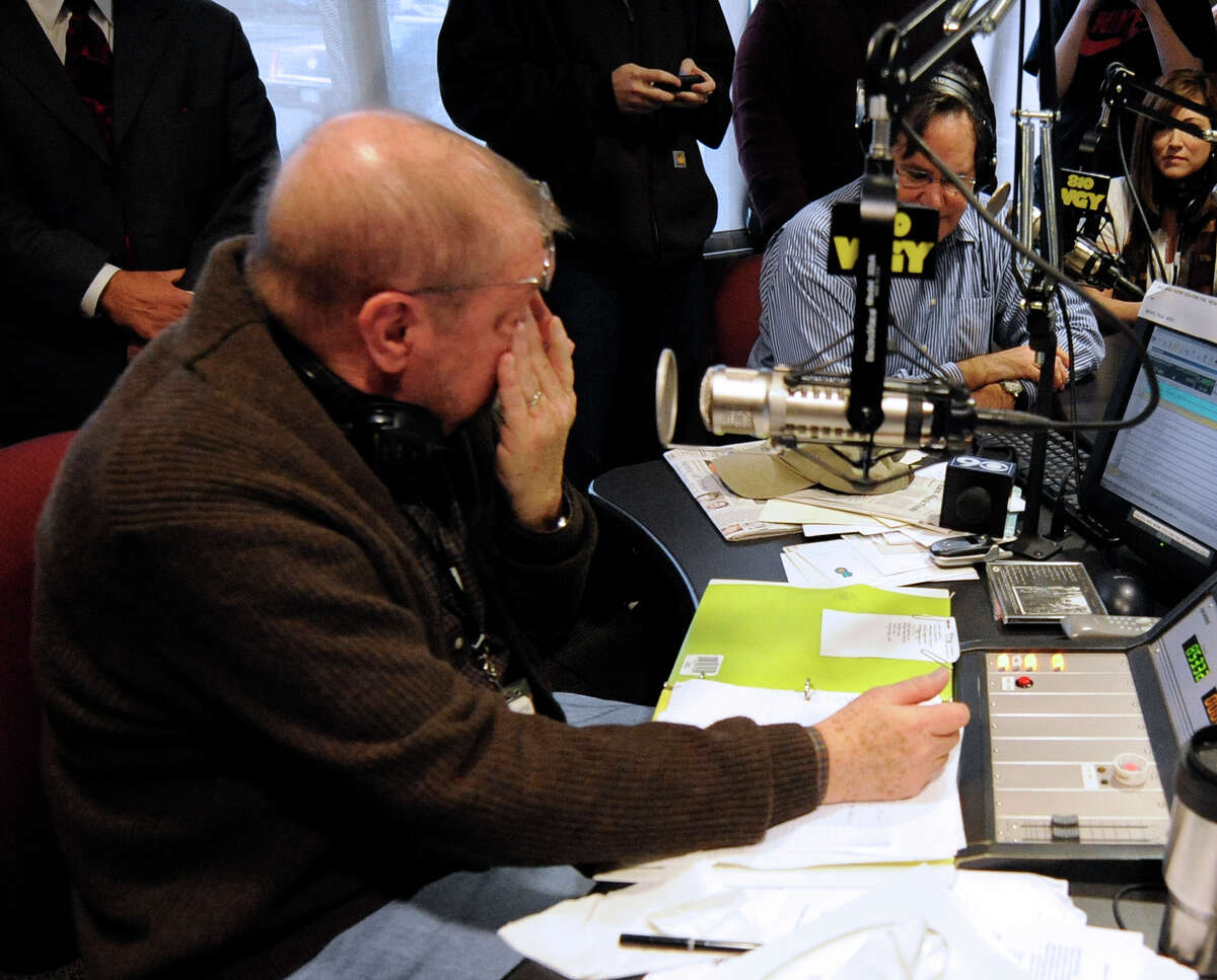 Radio personality Don Weeks wipes a tear from his eye as he winds up his last moments after a thirty year career at WGY in Latham December 3, 2010. (Skip Dickstein / Times Union)