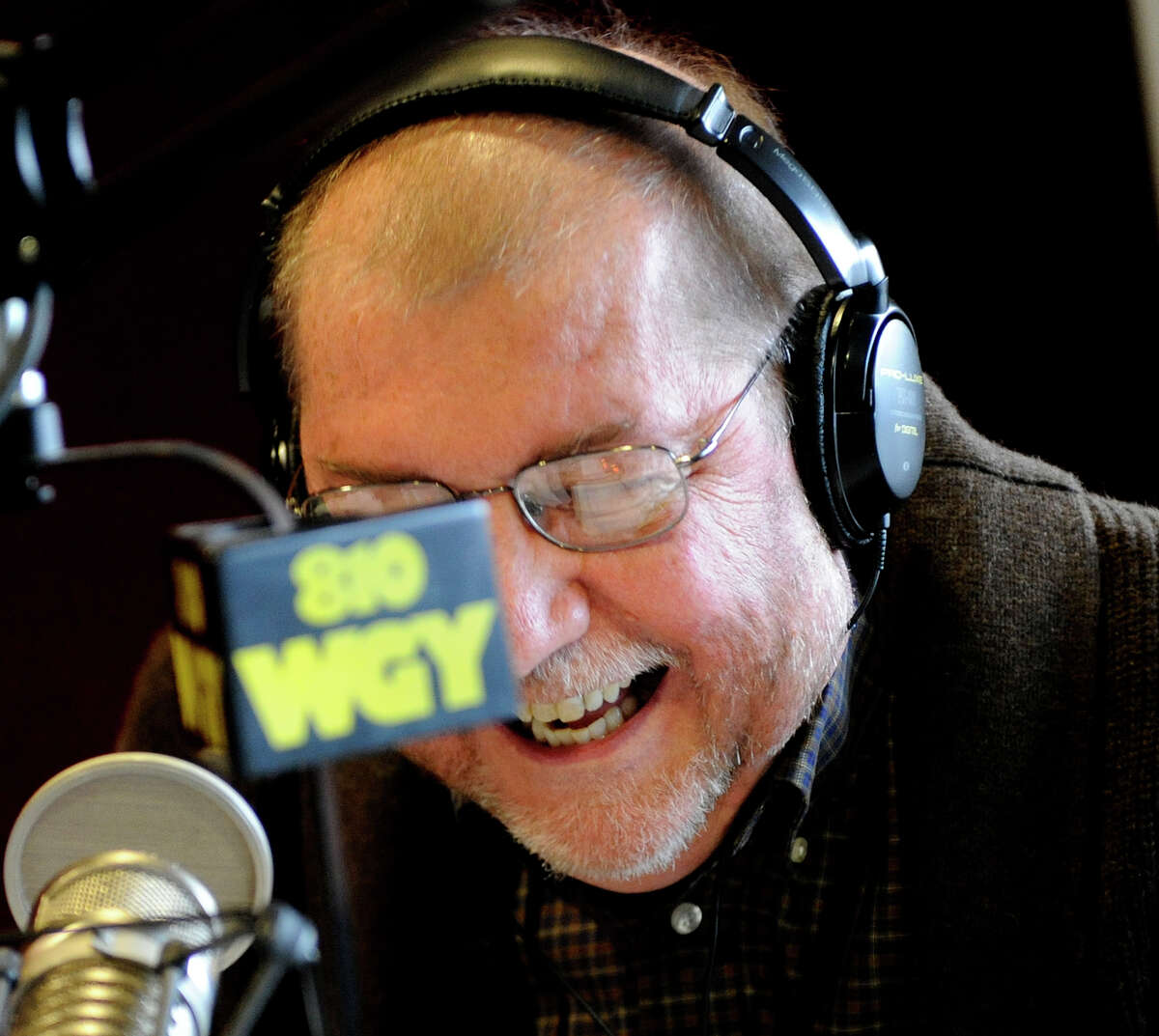 Radio personality Don Weeks enjoys a last laugh as he winds up his last moments after a thirty year career at WGY in Latham December 3, 2010. (Skip Dickstein / Times Union)
