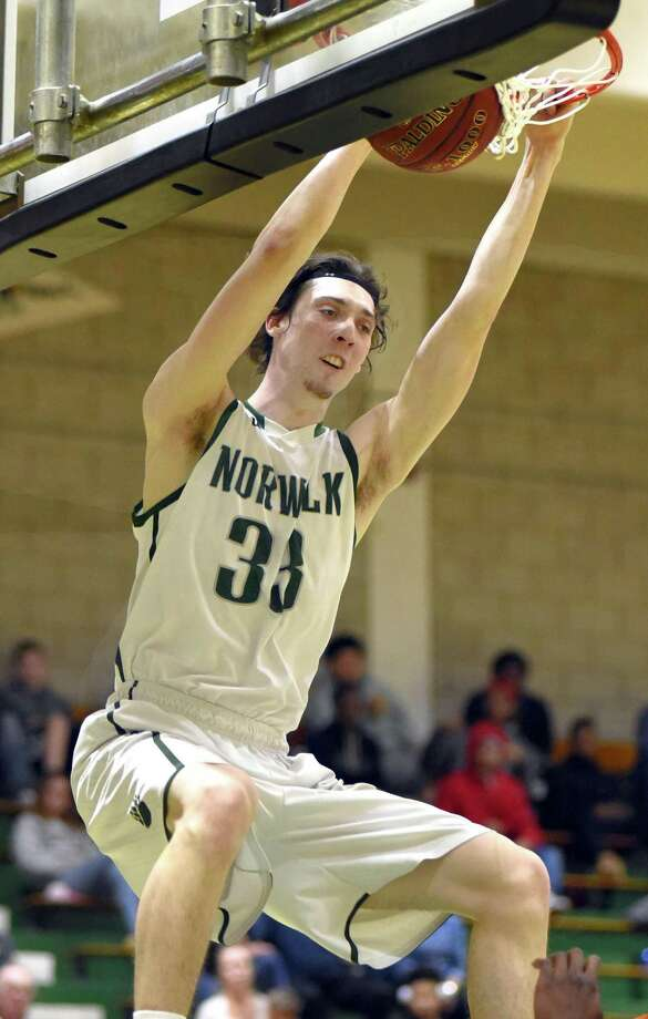 Norwalk's Peter Kotulsky dunks the ball during the second half of Tuesday's game. Photo: John Nash / Hearst Connecticut Media / Norwalk Hour