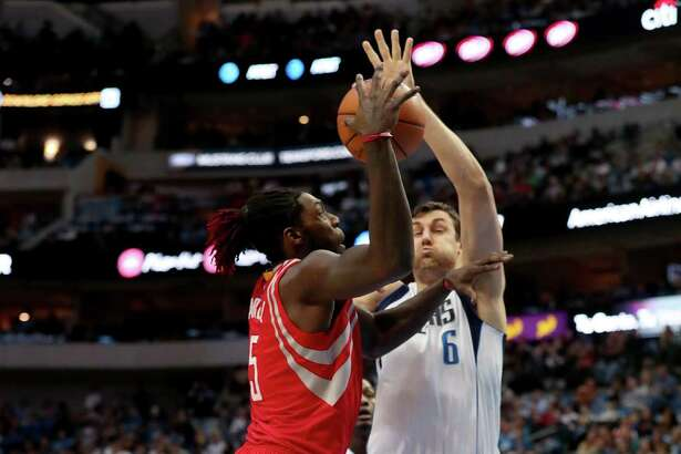 DALLAS, TX - DECEMBER 27:  Montrezl Harrell #5 of the Houston Rockets drives to the basket against Andrew Bogut #6 of the Dallas Mavericks in the first half at American Airlines Center on December 27, 2016 in Dallas, Texas. NOTE TO USER: User expressly acknowledges and agrees that, by downloading and or using this photograph, User is consenting to the terms and conditions of the Getty Images License Agreement.