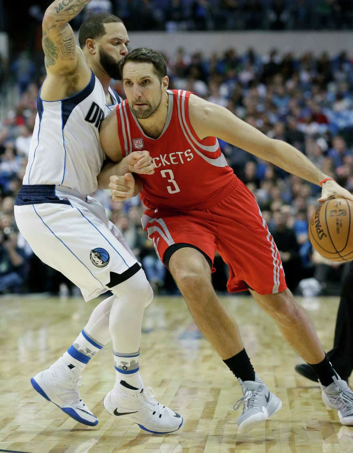 Houston Rockets forward Ryan Anderson (3) drives against Dallas Mavericks guard Deron Williams (8) during the first half of an NBA basketball game in Dallas, Tuesday, Dec. 27, 2016. (AP Photo/LM Otero)