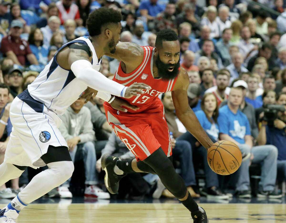 Houston Rockets guard James Harden (13) drives against Dallas Mavericks guard Wesley Matthews during the first half of an NBA basketball game in Dallas, Tuesday, Dec. 27, 2016. (AP Photo/LM Otero)