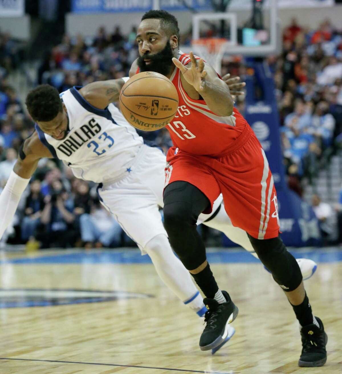 Houston Rockets guard James Harden (13) drives past Dallas Mavericks guard Wesley Matthews (23) during the first half of an NBA basketball game in Dallas, Tuesday, Dec. 27, 2016. (AP Photo/LM Otero)