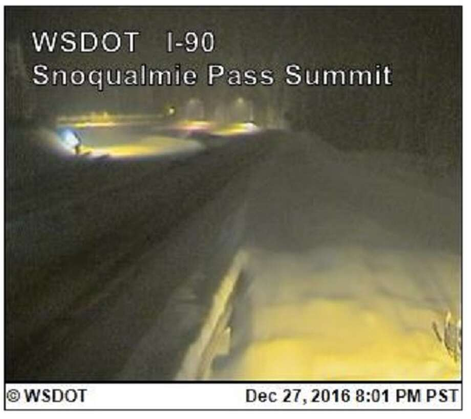 A WSDOT camera shows Snoqualmie Pass near the summit. The pass is closed eastbound after spinouts and collisions stalled travel. Photo: WSDOT