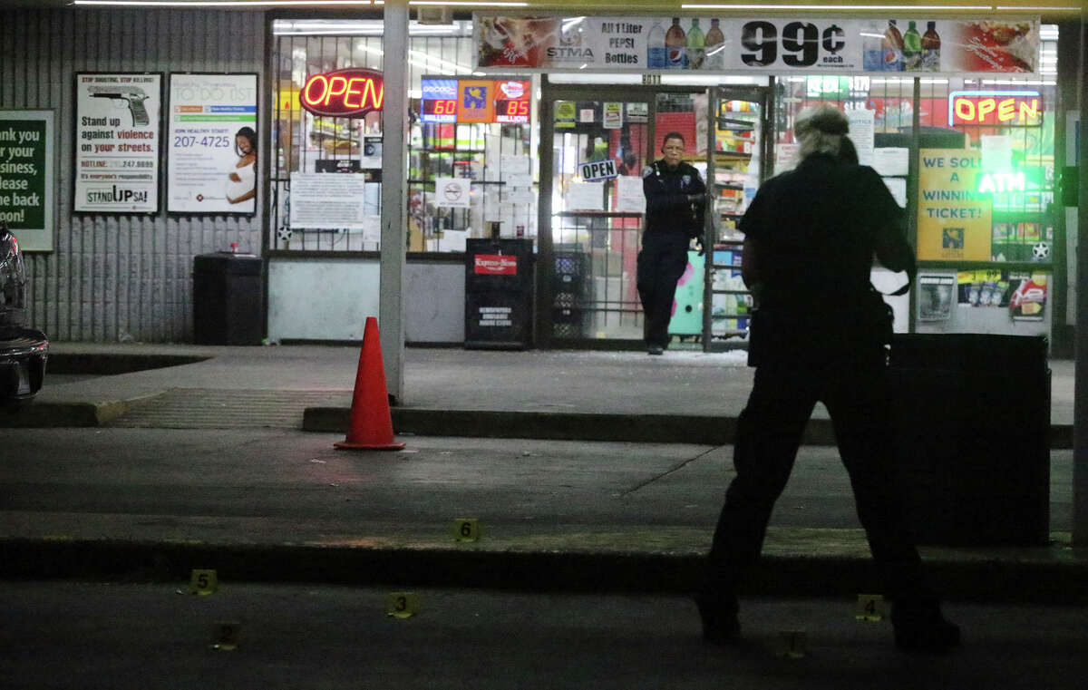 San Antonio police investigate Tuesday December 27, 2016 in front of the Right Choice Food Mart on the 8,000 block of Midcrown where a shooting took place. At least one person was shot in the hand Tuesday night during a shootout at a Northeast Side gas station left littered with shell casings and broken glass.