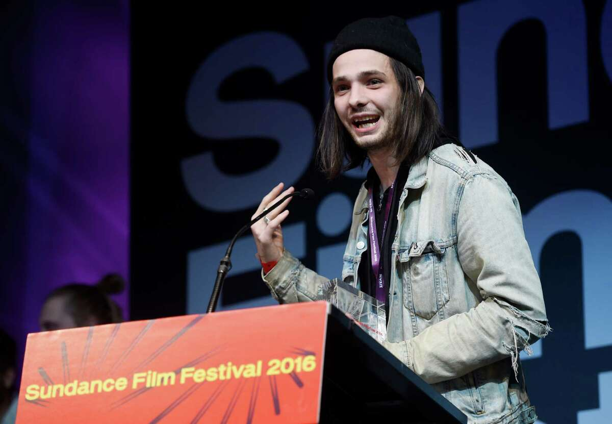 """Miles Joris-Peyrafitte, co-writer/director of """"As You Are,"""" accepts the U.S. Dramatic Special Jury Award for the film during the 2016 Sundance Film Festival Awards Ceremony on Saturday, Jan. 30, 2016, in Park City, Utah. (Photo by Chris Pizzello/Invision/AP) ORG XMIT: UTCP130"""