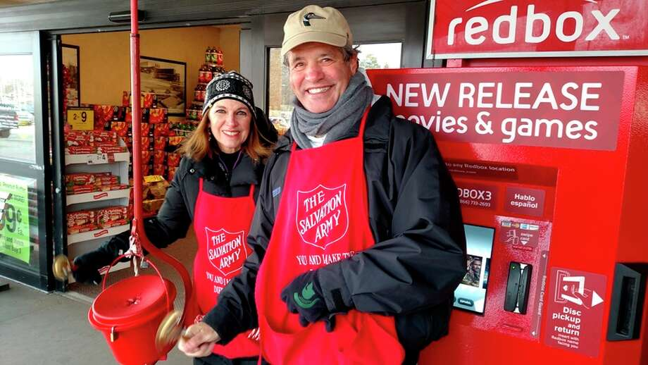 Sharon Mortensen and Jerry Wasserman of Midland Noon Rotary ringing bells for the Salvation Army in this provided photo.