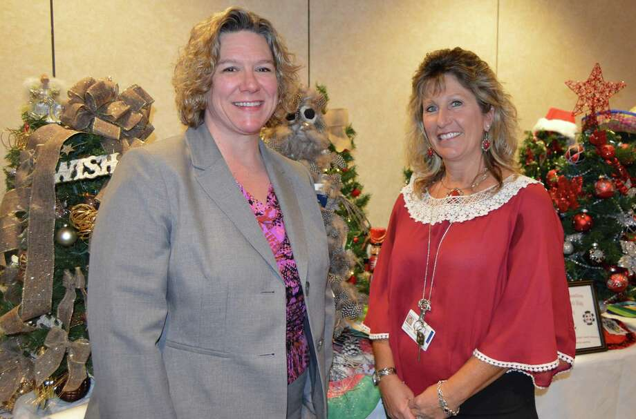 Susan Agamy, Executive Director of Spooner House, left, joined Kim Hall, Sr. Applications Coordinator at Griffin Hospital, and hospital staff in drawing tickets for the Holiday Wonderland of Trees fundraiser on Dec. 21. Photo courtesy of Griffin Hospital. Photo: Credit / Credit