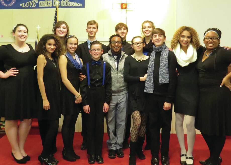 Group 12, a vocal jazz ensemble, performed at Wesley Chapel A.M.E. in Edwardsville Tuesday night. The group, directed by Paul Herbert Pitts, is composed of middle school and high school students from throughout the Metro-East. They were accompanied by several guest soloists, including Yolanda Cheeseboro, T.C. (Thomas) Evans, and Jasmine French. Photo: Carol Arnett • Intelligencer