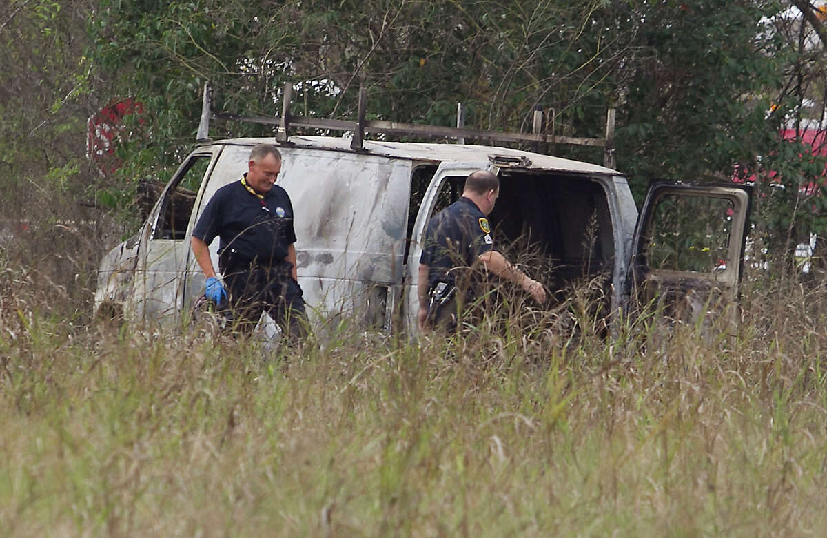 A body as found in a burned van about 8 a.m. Wednesday, Dec. 28, 2016 in the 5200 block of East Houston near Liberty. (Patric Schneider/Houston Chronicle)
