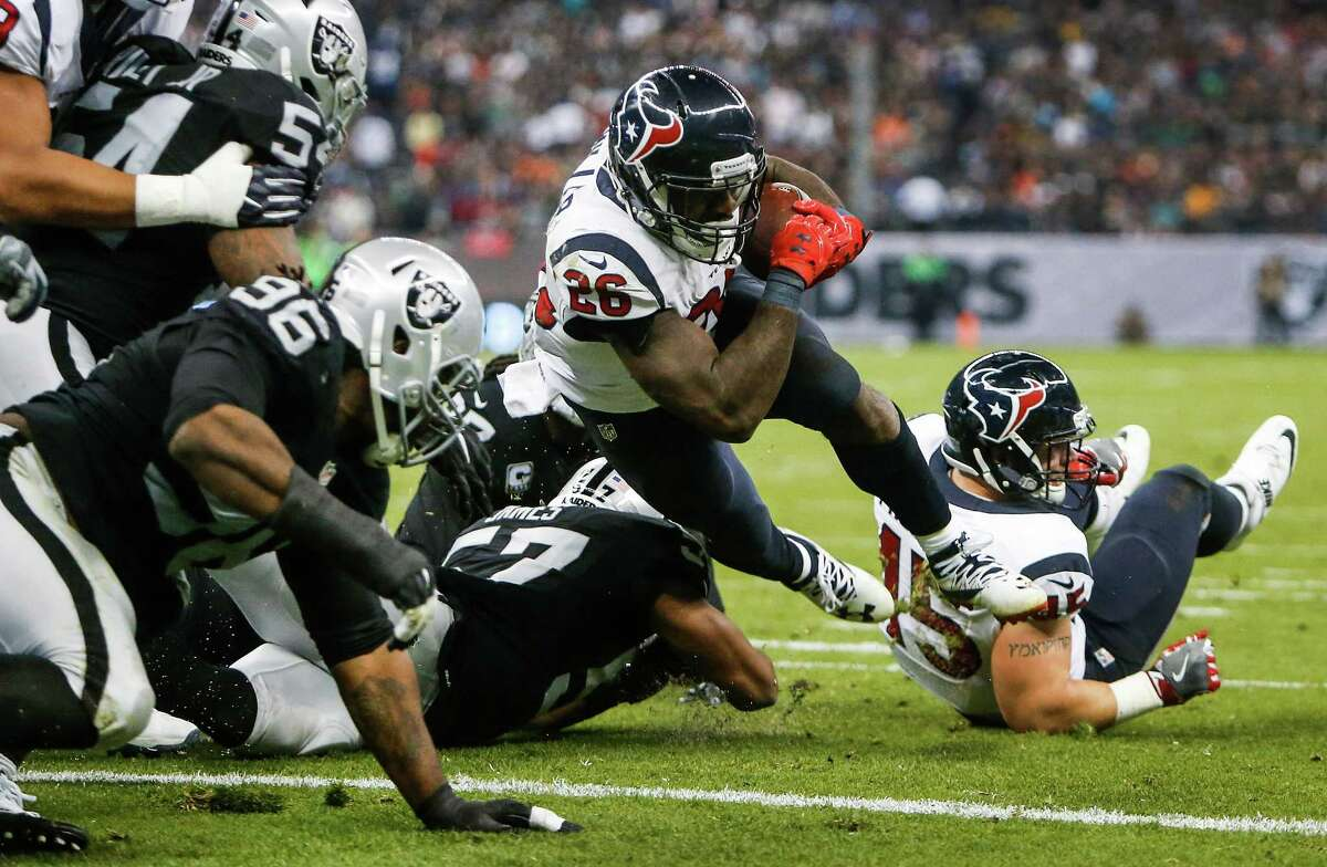 Houston Texans running back Lamar Miller (26) dives into the end zone for a 1-yard touchdown run against the Oakland Raiders during the third quarter of an NFL football game at Estadio Azteca on Monday, Nov. 21, 2016, in Mexico City.