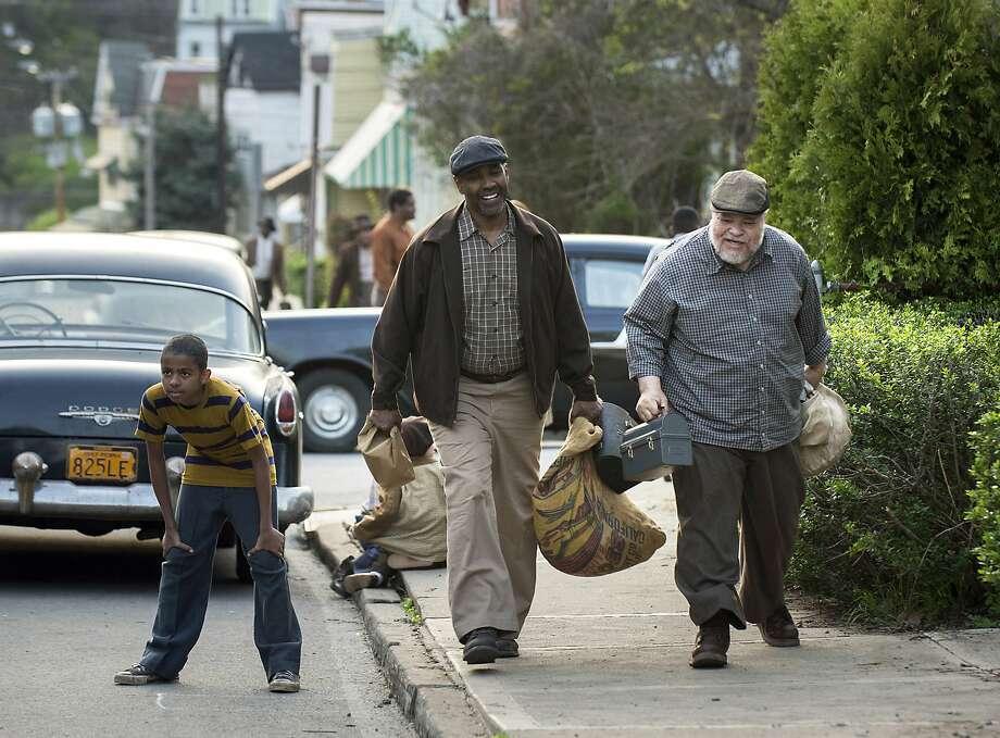 "Denzel Washington (center) and Stephen McKinley Henderson in ""Fences."" Photo: David Lee, Associated Press"