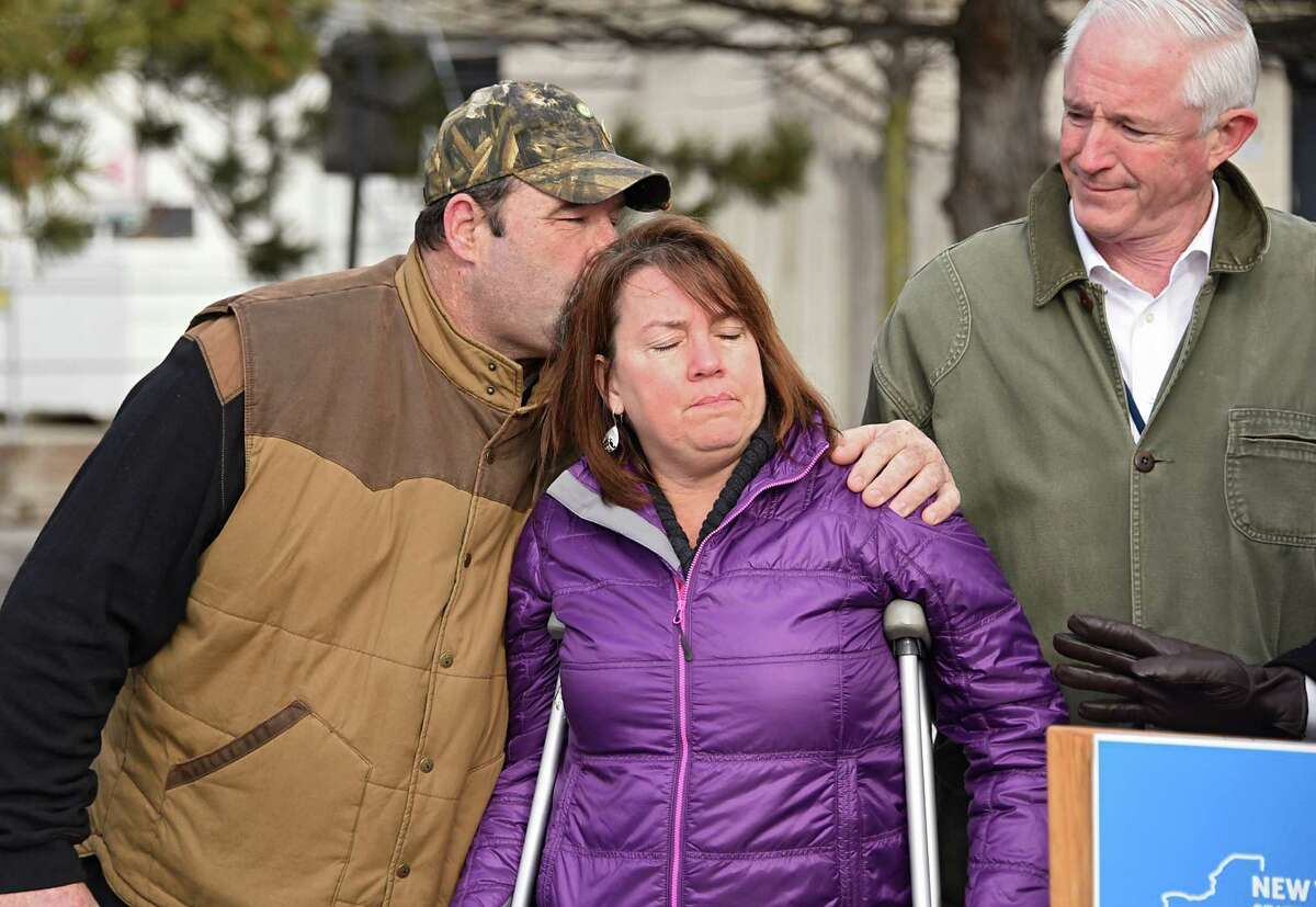 Bucky Golas gives his fiancee Sandy LaPlante a kiss after she spoke about the accident they were in which caused her to lose her leg at a press conference urging people not to drink and drive this holiday weekend and the year to come near the exit 24 tollbooths on the NYS Thruway on Wednesday, Dec. 28, 2016 in Albany, N.Y. The couple were on their motorcycle when a drunk driver hit them. The NYS Thruway Authority, Mothers Against Drunk Driving (MADD) and New York State Police Troop T kicked off the 30th annual Red Ribbon DWI Prevention initiative. Bill Finch of The New York State Thruway Authority stands to the right. (Lori Van Buren / Times Union)