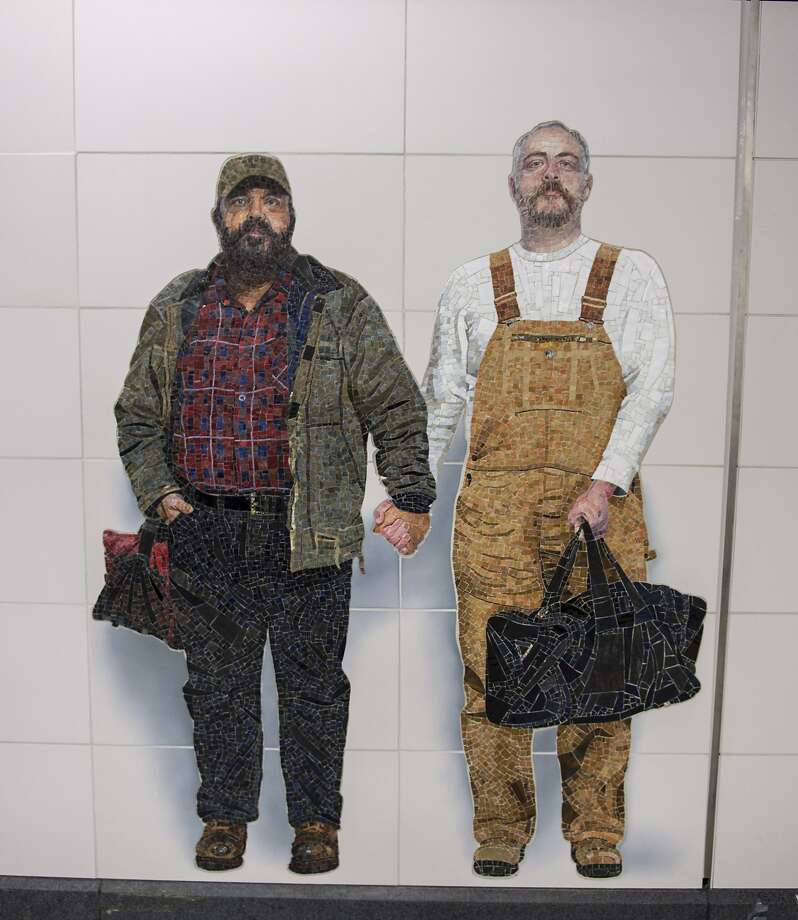 The mural is based on a photo of Thor Stockman (left) and his husband, Patrick Kellogg. Photo: Associated Press