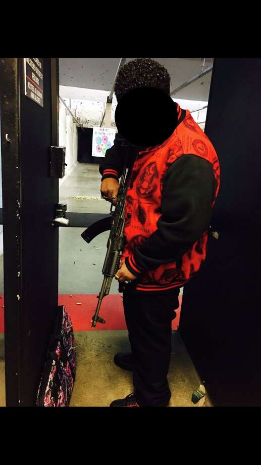 A pair of 24-year-old felons with multiple convictions were arrested  last week after photos of themselves holding assault rifles were posted  to Facebook, according to Seattle police. Photo: Facebook