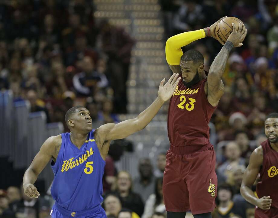 Cleveland Cavaliers' LeBron James (23) passes against Golden State Warriors' Kevon Looney (5) in the first half of an NBA basketball game, Sunday, Dec. 25, 2016, in Cleveland. (AP Photo/Tony Dejak) Photo: Tony Dejak, Associated Press