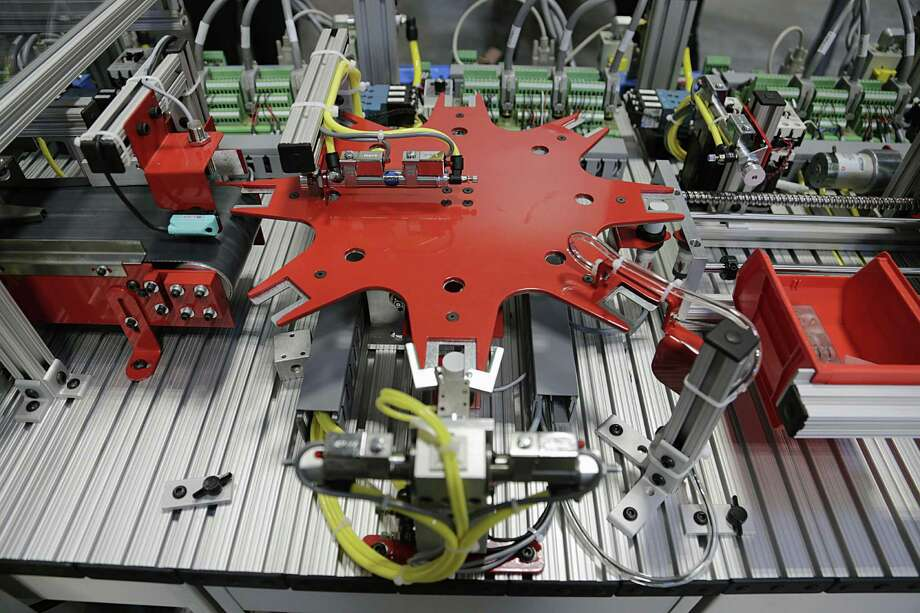 A robotic unit in the Robotics and Mechatronics lab at the Houston Community College's Advanced Manufacturing Center of Excellence. An analysis from Ball State University attributed only 13 percent of manufacturing job losses to global trade, the remainder to automation. Photo: James Nielsen /Houston Chronicle / © 2016  Houston Chronicle