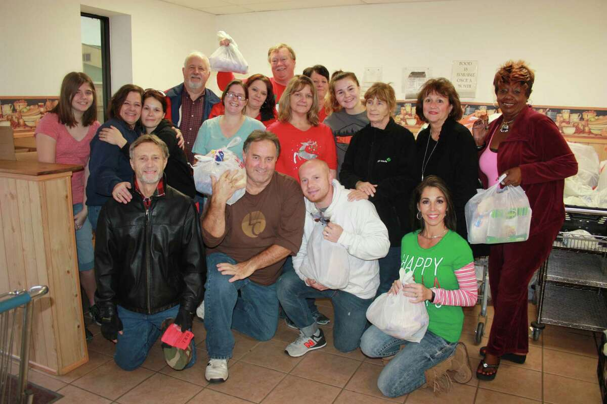 For the last 15 years, Operation Refuge Food Pantry has fed the hungry in the Cleveland area. On Dec. 16, a small army of volunteers helped package Christmas food items for 300 families. The food was donated by Liberty Church, H-E-B, Brookshire Bros. and other groups and individuals.