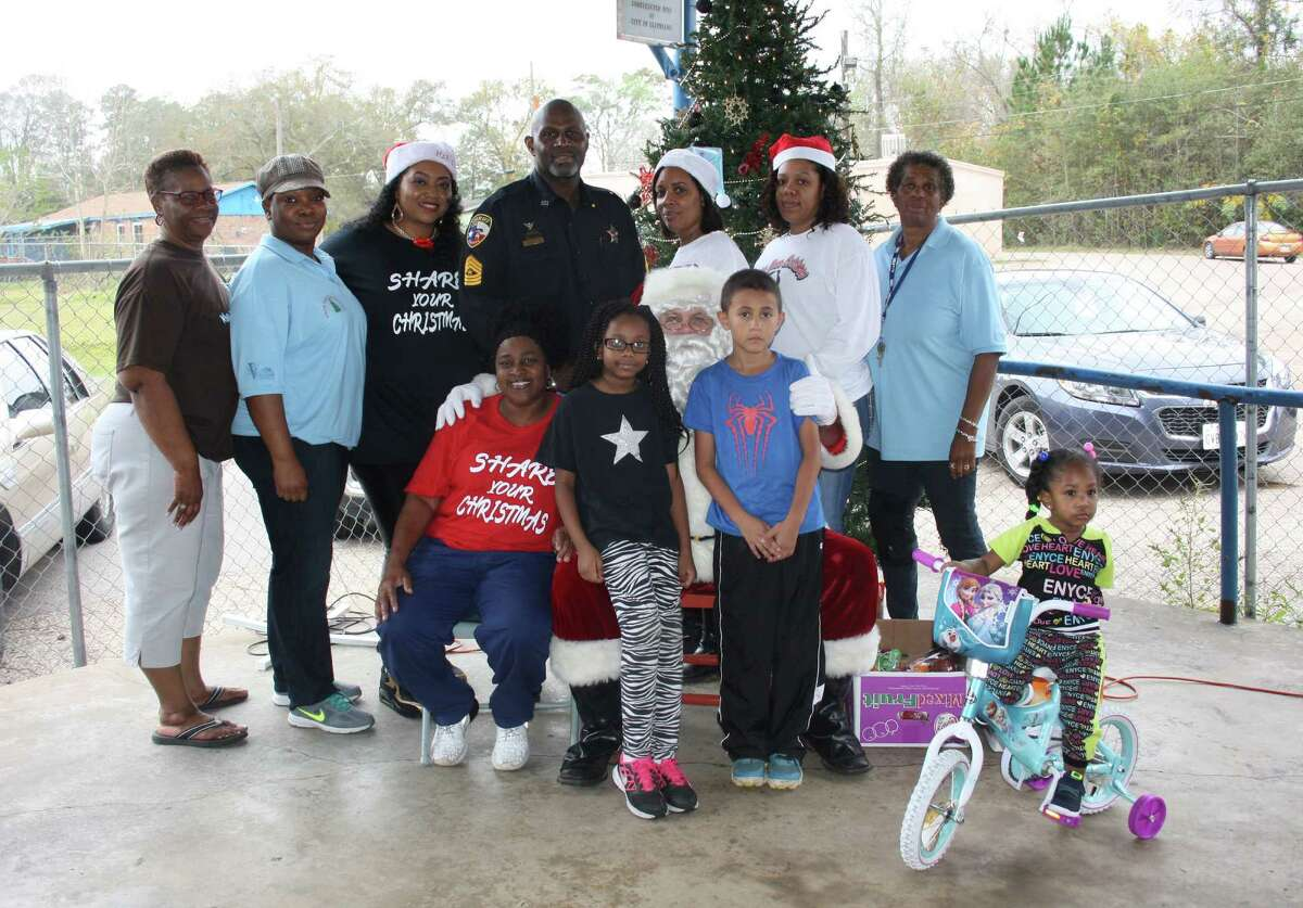 Share Your Christmas brightened Christmas for 284 local children this year by providing toys and gifts just in time for the holidays. Some of the children even received new bicycles. The funds used for Share Your Christmas are raised from all across Liberty County, according to John Davis, one of the organizers. Share Your Christmas, founded by Dinah Cochran, is in its 25th year. Pictured (front row) are Dinah Cochran, Ja'Niy Jackson, Santa Claus, Adan Lira, Peyton Wilridge, (back row) Gloria Harrison, Latonya Ellerby, Keisha Gonzales-Carr, John