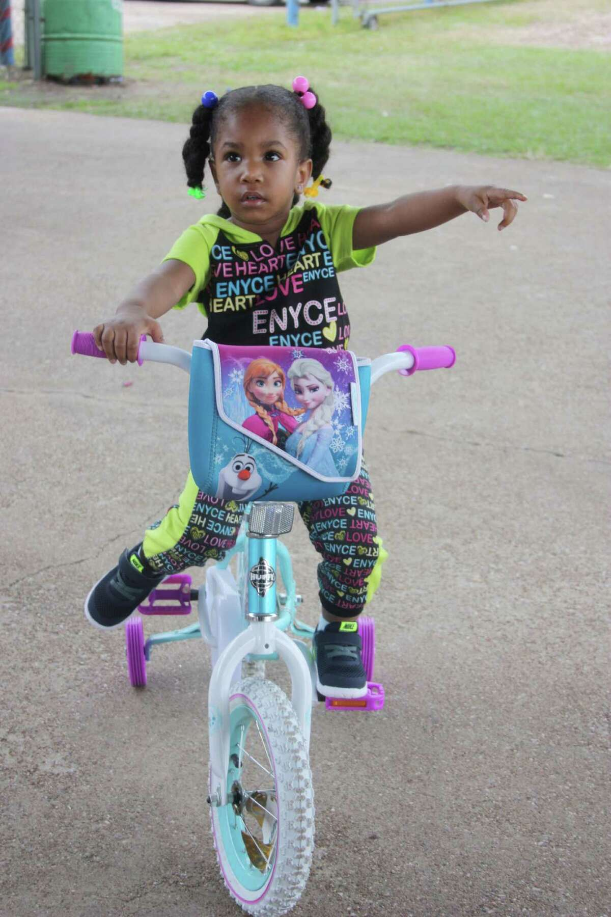 Peyton Wilridge sits on her new bicycle that was provided through Share Your Christmas.
