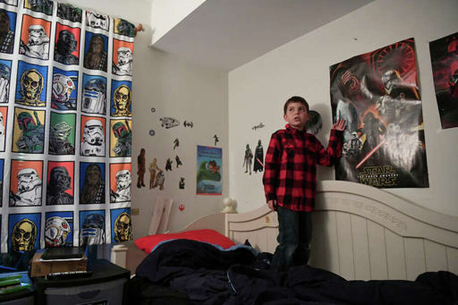 In this Dec. 13, 2016, photo, Joe Maldonado, 8 stands in his room in Secauscus, N.J. The family of Maldonado says he was kicked out of Cub Scouts because he is transgender, a move that could open a new front in the debate over discrimination in Scouting. (Danielle Parhizkaran/Northjersey.com via AP) Photo: Danielle Parhizkaran/AP