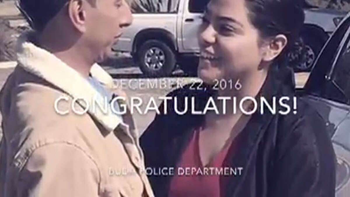 Officers with the Buda, Texas, Police Department conducted a fake traffic stop in a parking lot to help a young man carry off a surprise marriage proposal, Dec. 22, 2016.