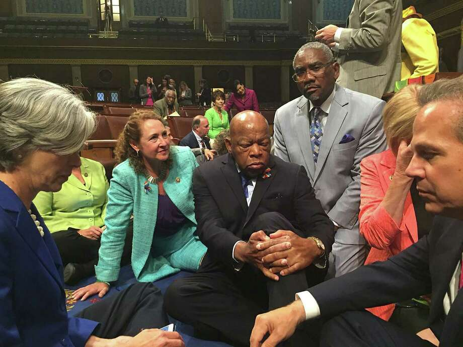 """This image courtesy of Democratic Rep. Elizabeth Esty's office shows Rep. Esty(2n-L) with Rep. John Lewis(C) and other members of Congress staging a sit-in on the floor of the US House of Representatives on June 22, 2016 in Washington, DC. US Democrats staged a rare sit-in Wednesday in the House of Representatives, demanding that the Republican-led body vote on gun-control legislation following the Orlando nightclub massacre.""""We have to occupy the floor of the House until there is action,"""" Democratic Congressman John Lewis, a civil rights icon who marched with Reverend Martin Luther King Jr in the 1960s, said before he and dozens of colleagues sat down on the carpeted well of the chamber.The dramatic action came just as the House presiding officer moved to declare the body in recess.  / AFP PHOTO / Rep. Elizabeth Esty / Handout / RESTRICTED TO EDITORIAL USE - MANDATORY CREDIT """"AFP PHOTO /CONGRESSWOMAN ELIZABETH ESTY"""" - NO MARKETING NO ADVERTISING CAMPAIGNS - DISTRIBUTED AS A SERVICE TO CLIENTS  HANDOUT/AFP/Getty Images Photo: HANDOUT / AFP/Getty Images / AFP or licensors"""