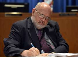California Public Utilities Commissioner Mike Florio writes during a hearing at the California Public Utilities office in San Francisco on August 11, 2015. The CPUC is considering tougher rules for back-channel talks with utilities like PG&E in spite of the fact that they are being  overseen by Florio, one of PG&E's main figureheads. (JOSH EDELSON/SPECIAL TO THE CHRONICLE)