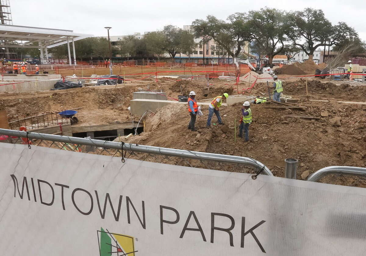 Construction crews work to complete Midtown Park before the Super Bowl, Wednesday, Dec. 28, 2016, in Houston.
